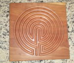 A picture of a wooden Labyrinth.