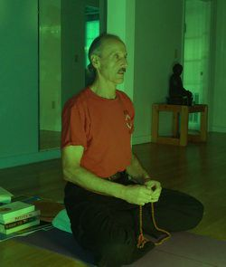 A picture of Swami Doing Mantra.