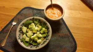 A picture of a salad and soup.