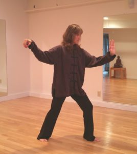 a picture of Lisa doing Tai Chi