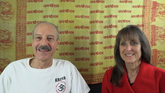 a picture of Lisa and Kenny doing the radio talk show The Key to Understanding Spiritual Yoga
