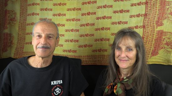 A picture of Lisa and Kenny doing the radio talk show titled Discovery Beyond Sense Level Limits.